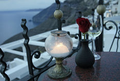 A vine glass and a rose on greece island Stock Photos