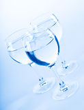 Vine glasses. Blue photo toned Royalty Free Stock Photo