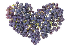 Vine grapes heart concept. Heart made from Vine red real simple autumn grapes berries. Isolated Stock Photography