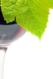 Vine leaf and  red wine Stock Photos