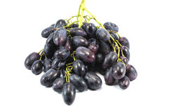 Vine of purple grapes isolated over white. Close-up of vine of purple grapes isolated over white Royalty Free Stock Images