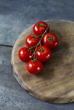 Vine ripe tomato. Fresh tomatoes on rustic wooden table stock images