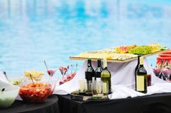 Vine on table. Vine salad cheese and other food on buffet party outdoor stock image