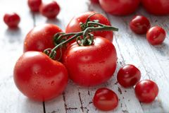 Fresh Tomatoes on Wood Surface Royalty Free Stock Images
