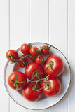 Vine Tomatoes in Rustic Bowl royalty free stock photos