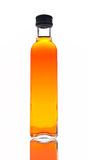 Vinegar bottle. One bottle of vinegar reflected on white background Royalty Free Stock Photos