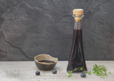 Vinegar in a bottle and in a  bowl Stock Photos