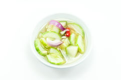 Vinegar with cucumber shallots on white Royalty Free Stock Photo