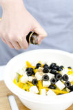 Vinegar pours on greek salad Royalty Free Stock Photo