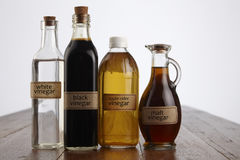 Vinegar. Various vinegar on the wooden table top Stock Photos
