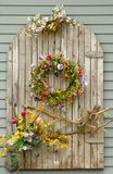 Vines and flowers on a wall Royalty Free Stock Image