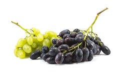 Vines of green and purple grapes isolated over white. Close-up of vines of green and purple grapes isolated over white Royalty Free Stock Images