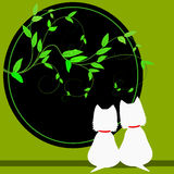 Vines and westies. Silhouettes of 2 West Highland white terriers looking out a round opening Royalty Free Stock Image