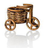 Vinewoven souvenir. Tricycle with basket Stock Photos