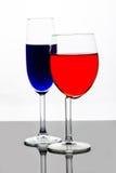 Vinexponeringsglas med champagneflöjten Royaltyfri Foto