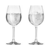 Vinexponeringsglas med sodavatten arkivbild
