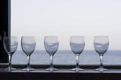 Vinexponeringsglas och hav Arkivbilder