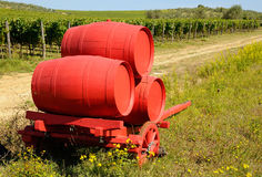 Vineyard in Chianti and old red wagon with wine barrels, Tuscany region. Vneyard in Chianti in Tuscany, Italy Stock Image