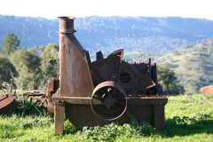 Vineyard Equipment. Old rusted equipment from the vineyard overlooking the valley Stock Image