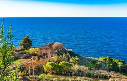 Vineyard garden with mediterranean Villa at sea coast. Idyllic view of mediterranean house with vineyard at beautiful coastline Stock Photo
