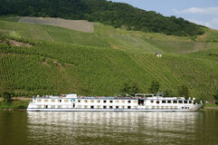 Vineyards and cruise ship on Moselle river Royalty Free Stock Photography