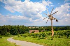 Vineyards and Klapotetz pinwheel at the South Styrian Wine Road in autumn, Austria Stock Image