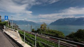 Vineyards near the railway station of the Lavaux region. Lavaux, Switzerland - July 12, 2015: Vineyards near the railway station of the Lavaux region over lake stock footage