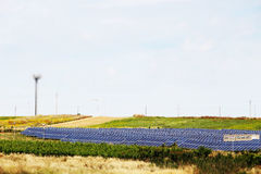 Vineyards with solar panels, miniature style. A detailed view of some hills and vineyards with a field of solar panels in the middle, miniature style, landscape stock image