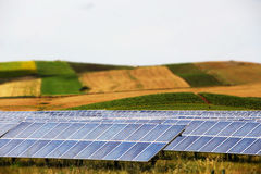 Vineyards with solar panels, miniature style. A detailed view of some hills and vineyards with a field of solar panels, pop colours, miniature style, landscape stock photos
