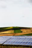 Vineyards with solar panels, miniature style. A detailed view of some hills and vineyards with a field of solar panels, pop colours, miniature style, portrait stock photo