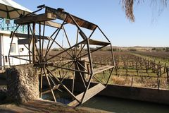 The vineyards and water wheels of Keimoes are world famous. And in a good year its raisin crops are exported throughout the globe.Orange River Wine Route stock photography