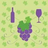 Vinflaskexponeringsglas och druvor Royaltyfri Foto