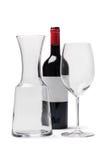 Vinflaskexponeringsglas och karaff med den snabba banan Arkivbilder