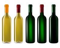 Vinflaskor i rad Royaltyfri Bild