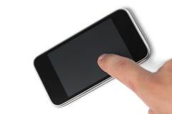 Vinger die mobiel aanrakingsapparaat met behulp van Stock Foto's