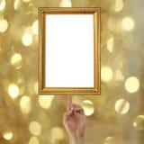 vinger van een zakenman die aan een Gouden omlijsting op BO richten Stock Foto