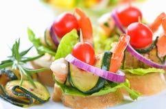 Vinger-voedsel met Scampi stock foto's
