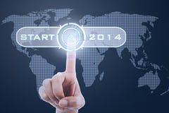 Vinger wat betreft knoopbegin tot 2014 Stock Afbeeldingen