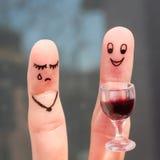 Vingerkunst van paar De vrouw is verstoord, is de mens gedronken royalty-vrije stock fotografie
