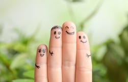 Vingers met tekeningen van gelukkige gezichten Royalty-vrije Stock Foto's