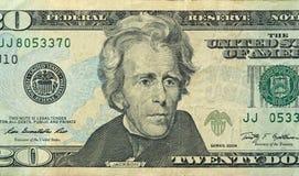 Vingt dollars avec une note 20 dollars Photographie stock libre de droits