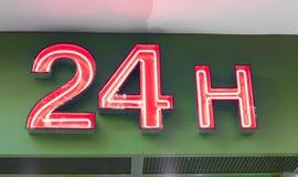 Vingt-quatre heures d'enseigne au néon Photo stock