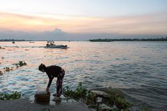 Evening laundry at Mekong river Stock Images