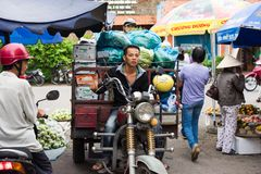 Vinh Long, Vietnam - Nov 30, 2014: Motorbike driver transporting fruits at Vinh Long market, Mekong delta. Transportation by motor. Bike is the fast, flexible Royalty Free Stock Photo