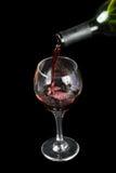 Vinho de derramamento em um vidro Imagem de Stock Royalty Free