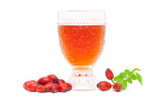 Vinho e frutas do Rosehip Foto de Stock