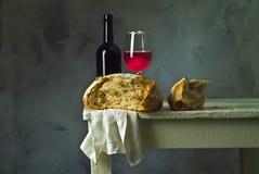 Vinho e pão Imagens de Stock
