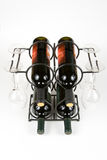 Vinho e vidros em uma cremalheira Imagem de Stock
