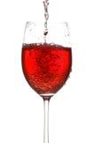 Vinho que derrama no wineglass Imagens de Stock
