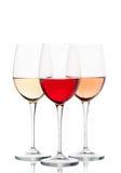 Vinho vermelho, cor-de-rosa e branco nos vidros Imagem de Stock